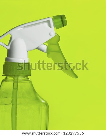 spray clean bottle over green background