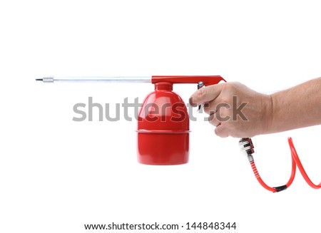 Spray gun and hand isolated - stock photo