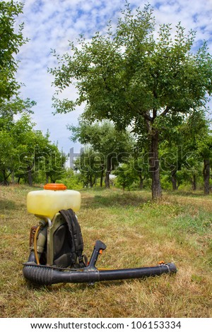 spray in an orchard - stock photo