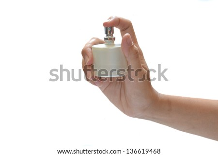 Spray in hand - stock photo