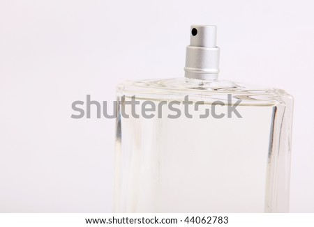 Spray of glass lotion bottle on white background.