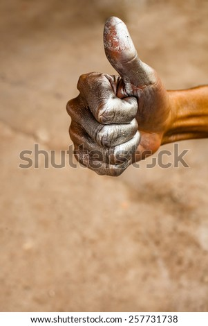Spray paint stained hands, thumbs, excellent. - stock photo