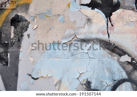 Spray painted wall cracked and peeling