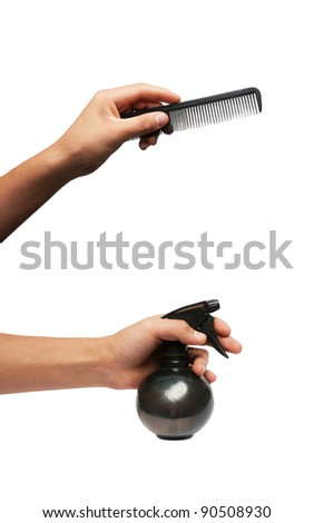 spray, razor, hairbrush in hand of a man on a white background
