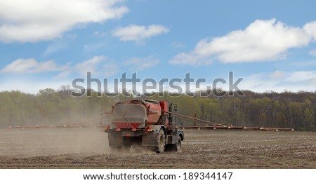 Spray truck applying chemicals to a farm field