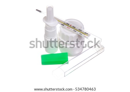 Spray tube with white pills and a thermometer on a white background