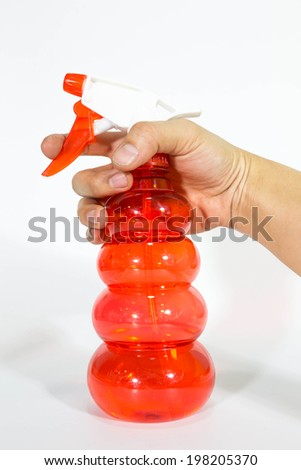 sprayer in hand on isolated - stock photo