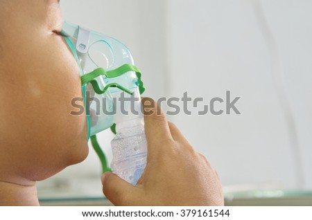 Spraying in medical for respiratory child patient. - stock photo