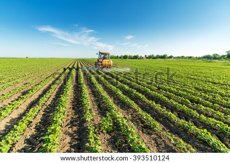 Spraying soybean crops - stock photo