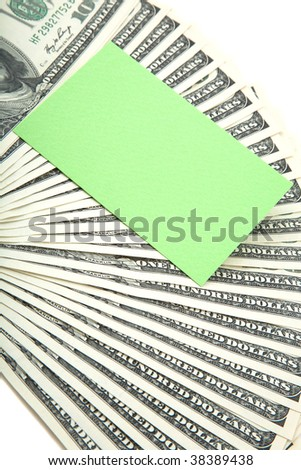 Spread of cash on white background with green blank card for text