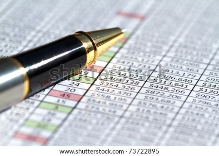 Spreadsheet and column of numbers from a business sales region - stock photo