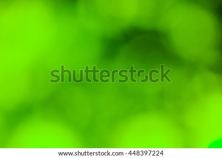 Spring abstract background, blurred sun light - bokeh. Green, yellow