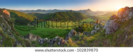 Spring and summer in Slovakia mountain - panoramic view with sun - stock photo