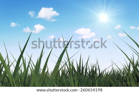 Spring and Summer Seasons Concept. Close-up View of Beautiful Meadow with Green Grass, Sunshine and Flowing Clouds over Blue Sky - stock photo