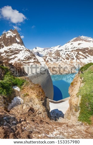 Spring at Emosson lake and huge concrete hydroelectric Dam near village of Chatelard, Swiss on the border with France - stock photo