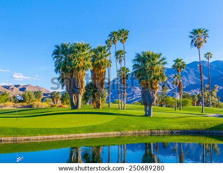 Spring at Palm Springs Golf course with pond,California - stock photo