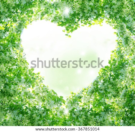 Spring background.Branches form a heart-shaped pattern