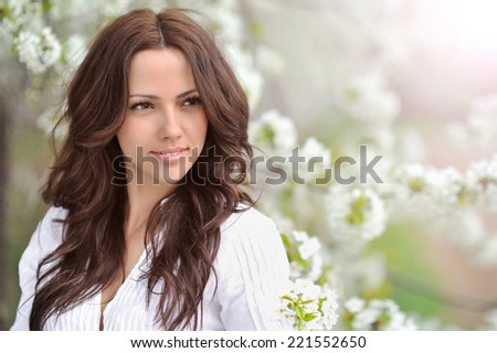 Spring beauty girl. Beautiful young woman in a summer park outdoor portrait  - stock photo