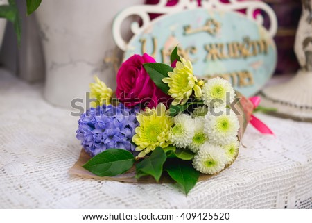 Spring bouquet of hyacinth, roses and chrysanthemums