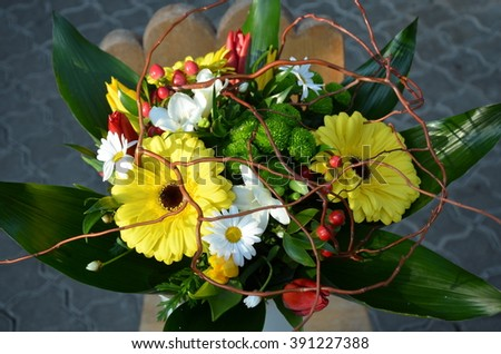 Spring bouquet with yellow gerebera, white daisies and tulips - stock photo