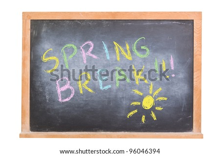 Spring Break written in colorful chalk on a chalkboard isolated on white.  There is also a sketched sun on the blackboard. - stock photo