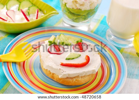 spring breakfast for child with funny face shape sandwich - stock photo