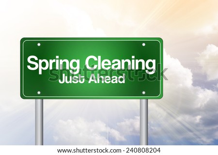 Spring Cleaning Just Ahead Green Road Sign, business concept - stock photo