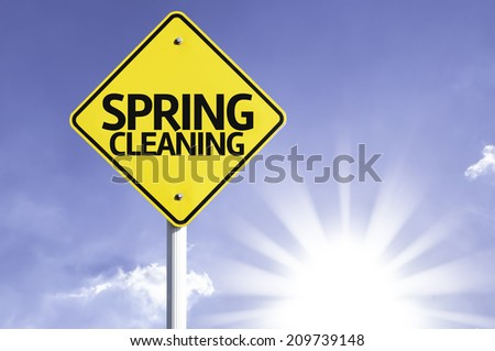 Spring Cleaning road sign with sun background - stock photo