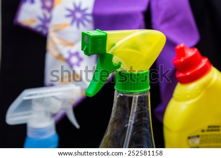 Spring-cleaning with spray bottle - stock photo