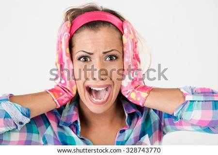 Spring cleaning woman screaming. She is stressed, wearing pink rubber gloves and looking at camera. White background. - stock photo