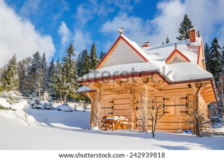 Spring comming to closed mountain hut in winter scenery - stock photo