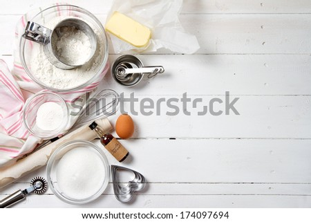Spring cookies ingredients - flour, sugar, egg, butter, baking powder, vanilla extract - stock photo