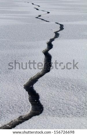 spring crack in ice - stock photo