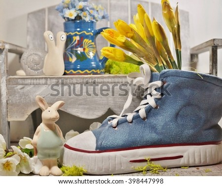 Spring decoration - clay pot shaped sneaker and daffodils