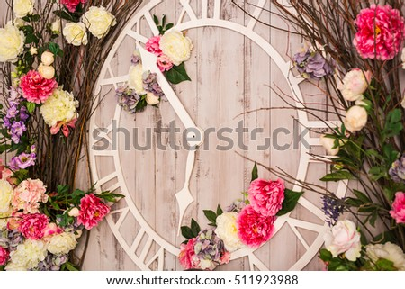 Spring decoration with a big clock in the interior