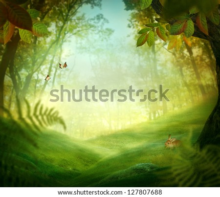 Spring design - Forest meadow. Nature Easter background with rabbit and grass in the deep forest - stock photo