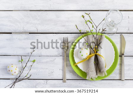 Spring Easter Table setting at wooden table. Top view. - stock photo