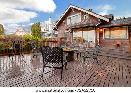 Spring exterior house with brown siding during Northwest spring. Tacoma, WA - stock photo
