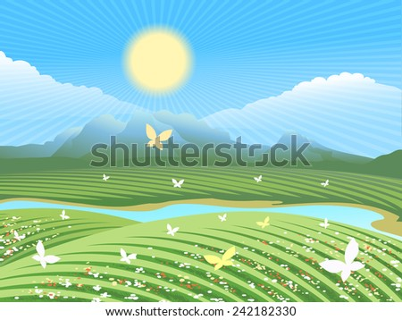 Spring farm landscape. Green field on the hills with flowers and butterflies near the river. The sun is shining in the distance visible mountains - stock photo