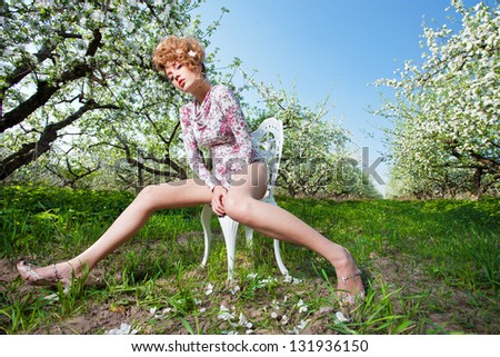 spring  fashion  blonde in the chair in a apple garden - stock photo