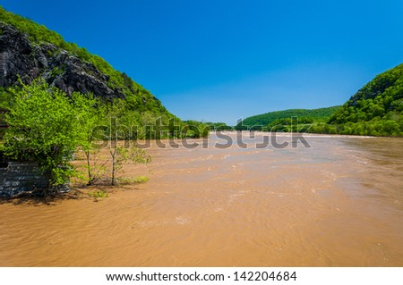 Spring flooding on the Potomac River in Harper's Ferry, West Virginia. - stock photo