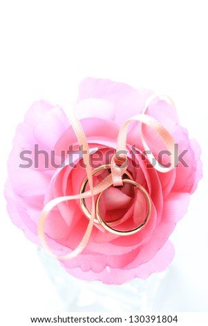 spring flower, pair of wedding ring on pink Ranunculus