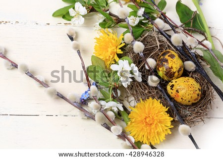 spring flowers composition bird's nest painted easter egg - stock photo