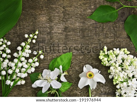 Spring flowers on a wooden texture - stock photo