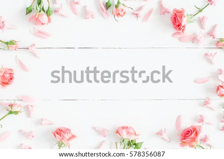 Spring flowers. Pink flowers on white wooden background. Flat lay, top view.