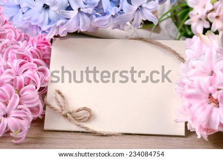 Spring frame surrounded by hyacinth blooms, space for your text - stock photo