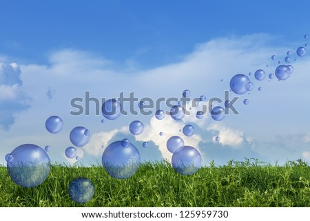 Spring fresh bubbles over green meadow against blue sky - stock photo