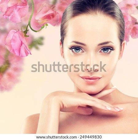 Spring freshness . A young girl with a pure and well-groomed skin. - stock photo