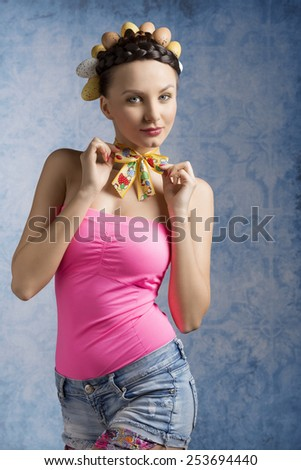 Spring, funny, cheerful, brunette woman, with nice hairstyle with eggs on the top and nice funny outfit. - stock photo