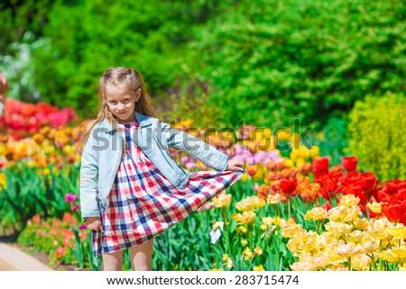 Spring garden, spring flowers - lovely girl and tulips - stock photo